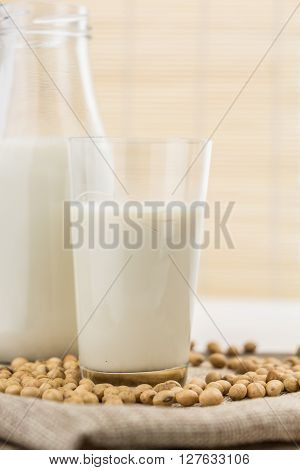 Bottle And Glass Of Soy Milk With Soybeans