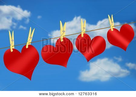 Red Hearts On Clothesline Against Blue Sky