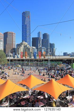 MELBOURNE AUSTRALIA - APRIL 24, 2016: Unidentified people dine in Federation Square in Melbourne.