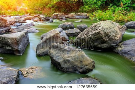 Scene with stones in mountain river at autumn time