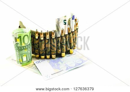 composition with a camouflage belt bullets and banknotes