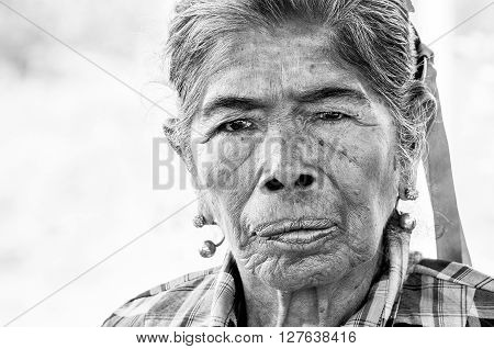 Pantanal, PARAGUAY in August 2015: Black and white portrait of an old indigenous woman in northern Paraguay. The the indigenous people of Paraguay struggle to reclaim their land sold by the government