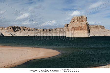Lone Rock in Lake Powell blue sky day. Arizona USA