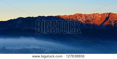 Romanian sunrise landscape in Carphatians Mountain