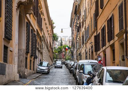 ROME, ITALY - APRIL 8, 2016: Street view with traffic and walking people