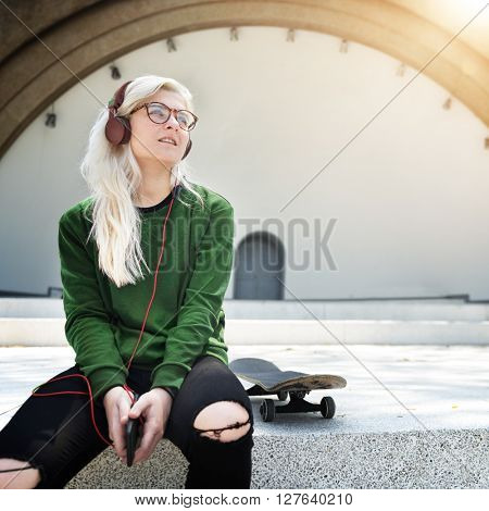 Young Woman Skater Listening Music Concept