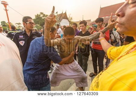 WAT BANG PHRA, THAILAND - MAR 19, 2016: Unknown participants of Master Day Ceremony at able Khong Khuen (spirit possession) during the Wai Kroo ritual at Bang Pra monastery, about 50 km of Bangkok.