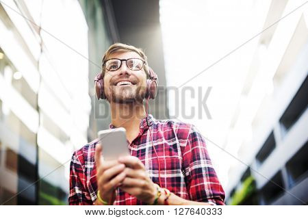 Man Walking Listening Misic Earphones Casual Concept