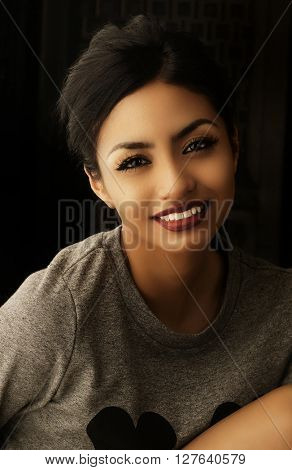 Beautiful young woman with happy sweet smile
