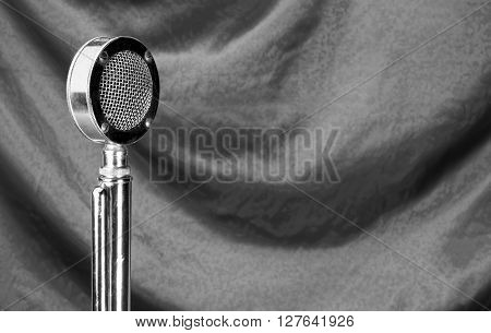 Old microphone in black and white with room for your type.