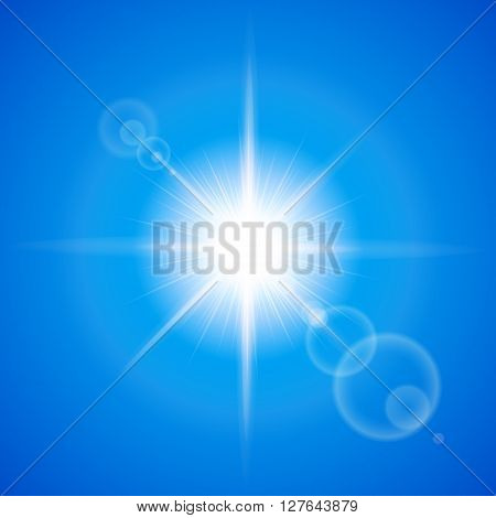 Glaring sun with lens flare over blue background
