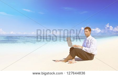 Businessman working at the beach.
