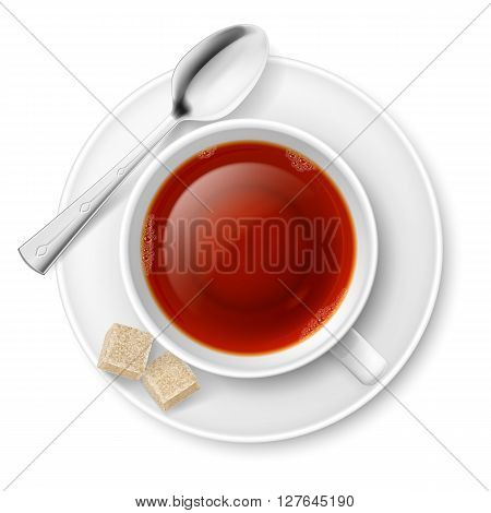 Cup of black tea with spoon and brown lump sugar