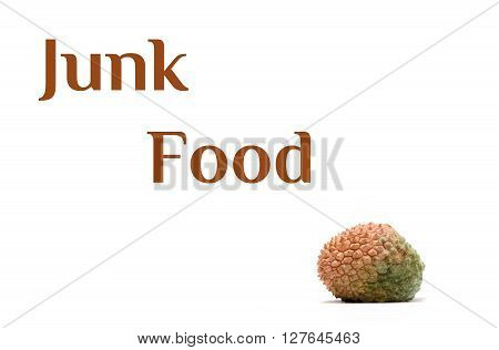 Junk food text and litchi isolated on white background.