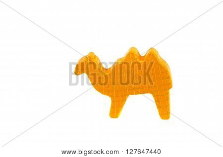 Yellow camel figurine isolated on white background