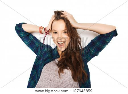 people, hair care, style and teens concept - happy smiling pretty teenage girl touching her head