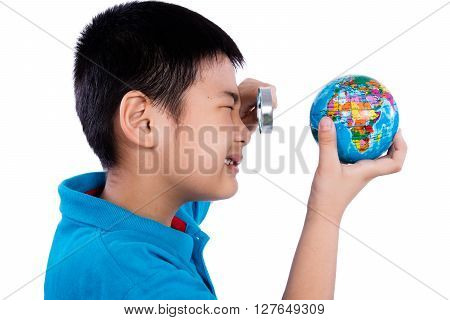 Asian Chinese Boy Looking At Globe Through Magnifying Glass