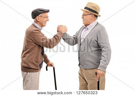 Two close senior friends greeting each other and smiling isolated on white background