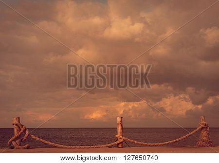 Seafront and cloudy sky in autumn. Turkey Erdek coast of Marmara. Toned landscape.