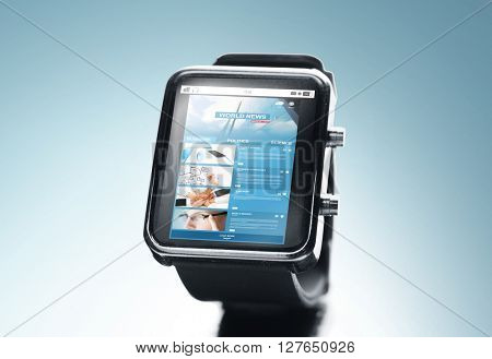 modern technology, mass media, application and object concept - close up of black smart watch with news web page on screen over blue background