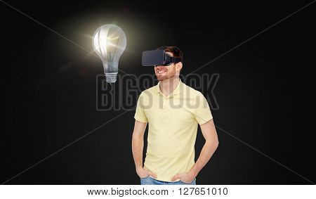 3d technology, virtual reality, idea, entertainment and people concept - happy young man in virtual reality headset or 3d glasses looking at light bulb over black background