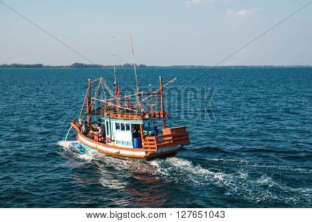 RAYONG, THAILAND - 2 JAN - Unidentified fishing boat with unidentified traveler passengers boating on ocean in Rayong, Thailand on January 2, 2016