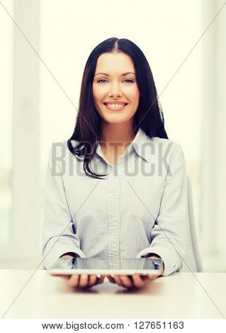 business, education, technology and internet concept - smiling businesswoman or student with tablet pc computer