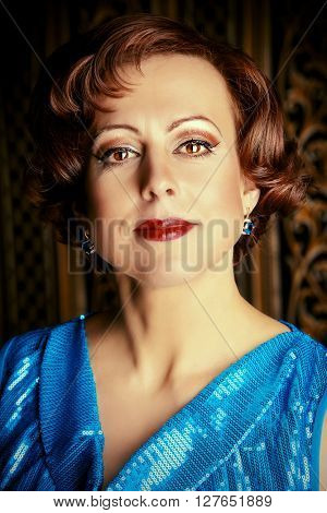 Portrait of a beautiful mature woman in evening dress over vintage background.