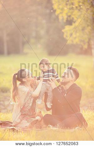 Happy Family In Park In Warm Sunny Day
