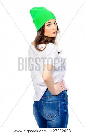 Cute young girl in everyday clothes posing at studio. Isolated over white backgroud.