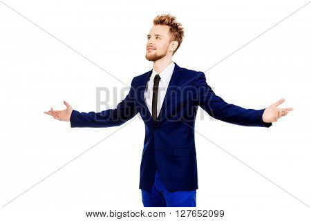 Smiling businessman spread his arms with joy. Success in business. Isolated over white.