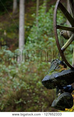 old hiking boots and cartwheel - closeup