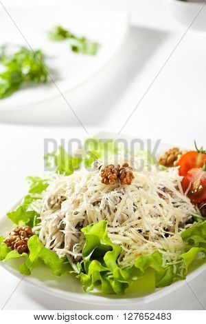 Salad with Parmesan Cheese and Walnuts