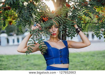 Beautiful Young Woman With Rowan Berries