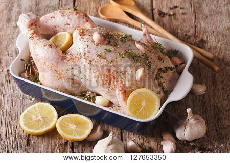 Raw Whole Chicken Marinated With Garlic, Thyme And Lemon Close-up. Horizontal