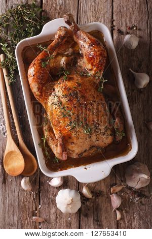 French Cuisine: Chicken With Forty Cloves Of Garlic Close-up. Vertical Top View