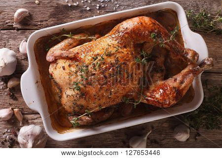 Chicken With Forty Cloves Of Garlic And Ingredients Close-up. Horizontal Top View