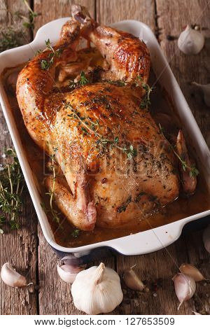 Chicken With 40 Cloves Of Garlic In The Dish For Baking And Ingredients Close-up. Vertical