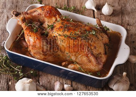 Chicken With Forty Cloves Of Garlic In The Dish For Baking Close Up. Horizontal