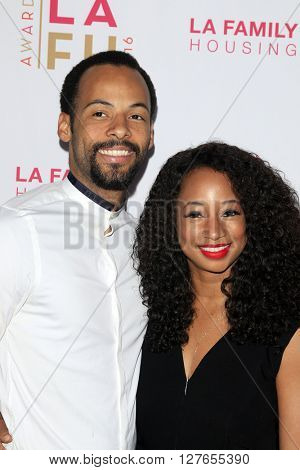 LOS ANGELES - APR 21:  Walter Jordan, Monique Coleman at the LA Family Housing Awards at the The Lot on April 21, 2016 in Los Angeles, CA