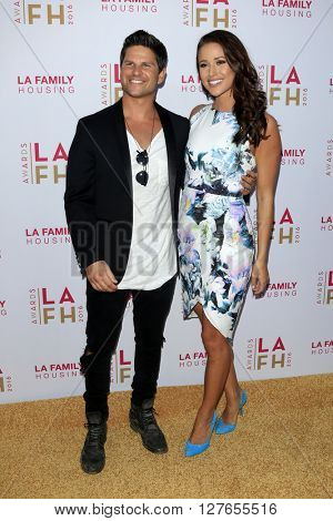 LOS ANGELES - APR 21:  Daniel Booko, Nia Sanchez at the LA Family Housing Awards at the The Lot on April 21, 2016 in Los Angeles, CA