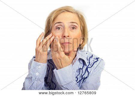 Senior Woman Checking Skin Face