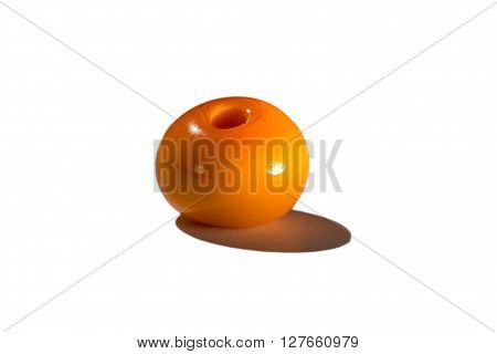 Hand made orange glass bead on white background