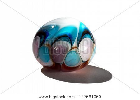 Hand made colour blue glass bead on white background