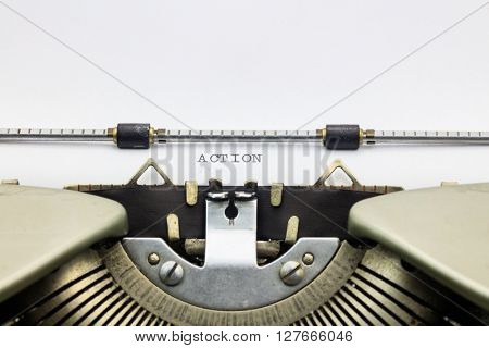 Close-up of word Action on typewriter sheet