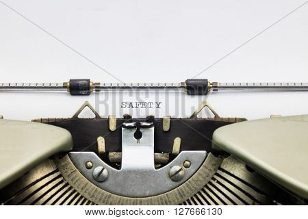 Close-up of word Safety  on typewriter sheet