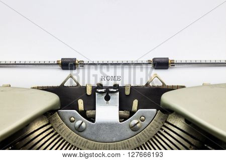 Rome word in capital letters on typewriter