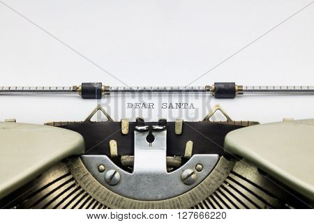 Close-up of of words Dear Santa on typewriter sheet