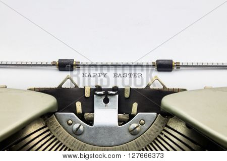 Close-up of of word Happy Easter on typewriter sheet