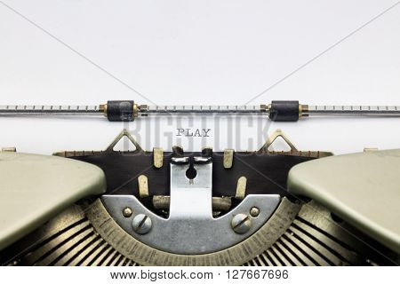 Close-up of word Play on typewriter sheet